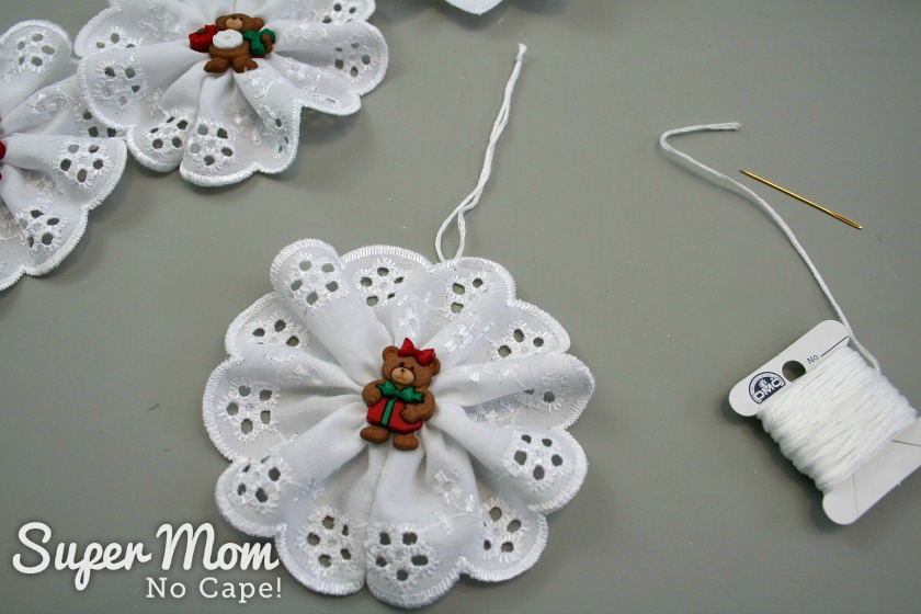 Finished Christmas Button Lace Ornament with the embroidery floss hanger added