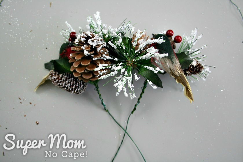 Floral wire added to the bird picks for the Christmas wreath