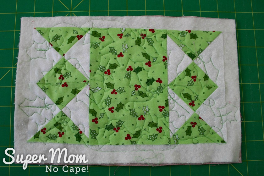 Holly leaf quilting on hourglass candle mat