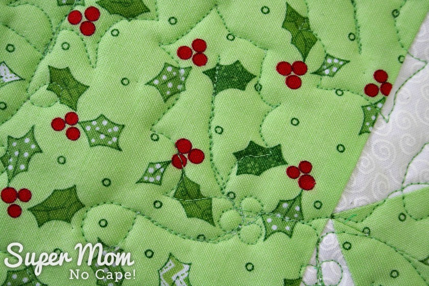 Close up of the holly quilt design