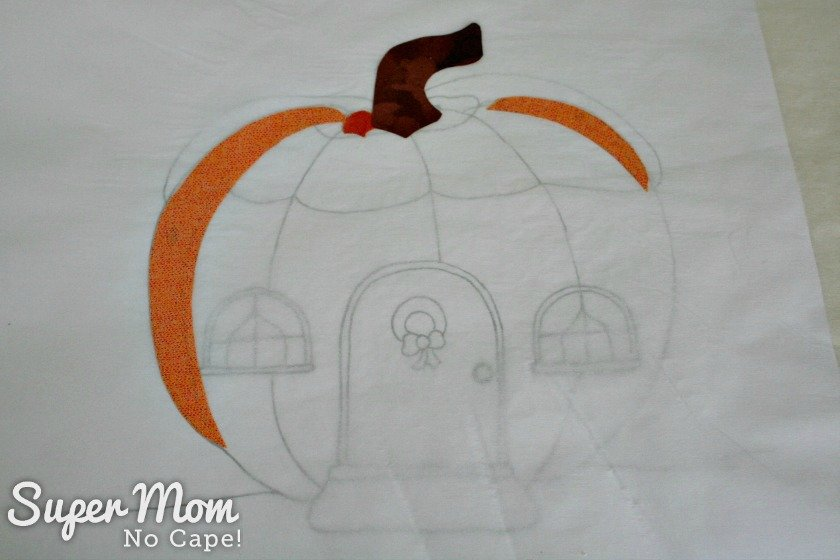 Fusing the pumpkin applique pieces for the Pumpkin Gnome House in place