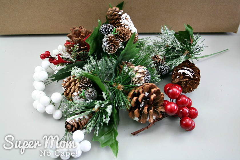 A variety of Christmas picks with pinecones and berries