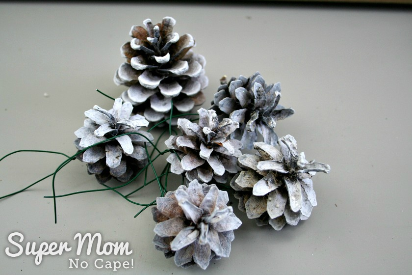 Pinecones spray painted white to add to the DIY Wreath kit