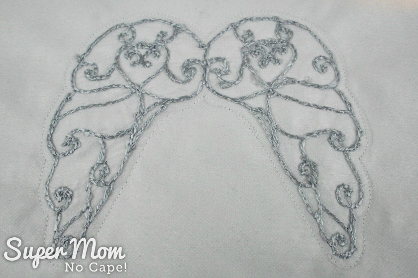 8 eighth inch seam allowance all the way around the embroidered angel wings