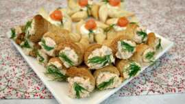 A plate of Mini Puff Pastry Cone Appetizers