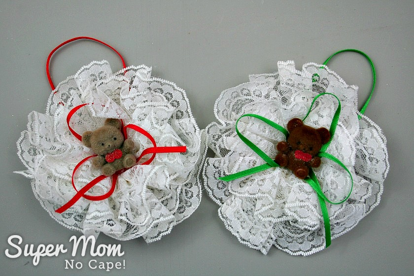 Two Lace Bear Ornaments with small flocked bears and ribbon in the center