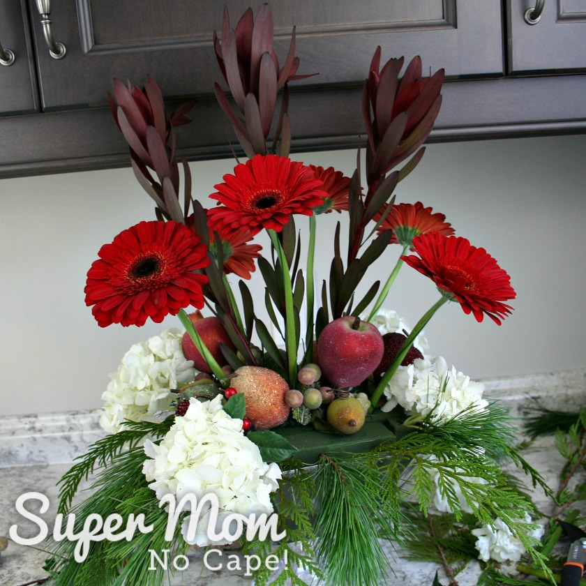 6 Red gerbera daisies added to the DIY Christmas floral arrangement