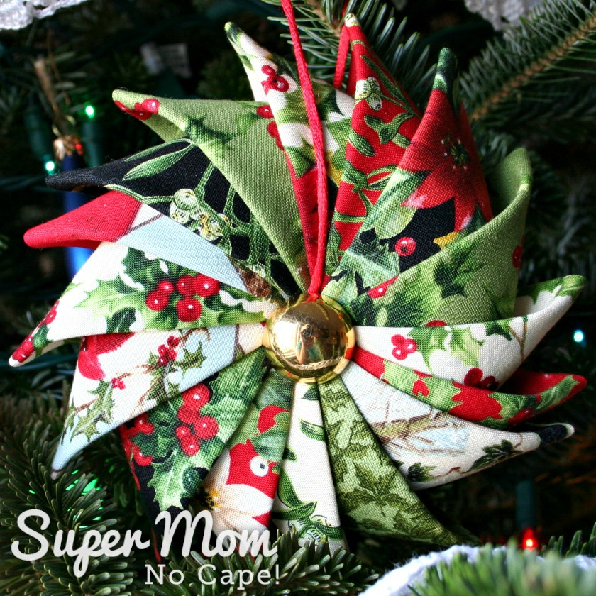 Prairie Point Star Ornament made with 16 different Christmas fabrics