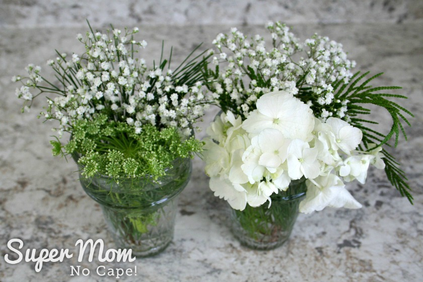 Two small flower arrangements made with leftover flowers from the DIY Christmas floral arrangement