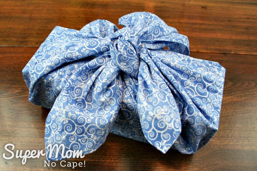 Box wrapped in blue Christmas furoshiki