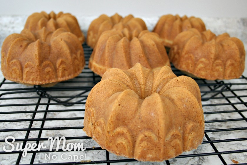 Closeup of seven Spiced Orange Buttercream Bundt Cakes