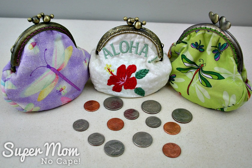 Coins scattered in front of three coin purses