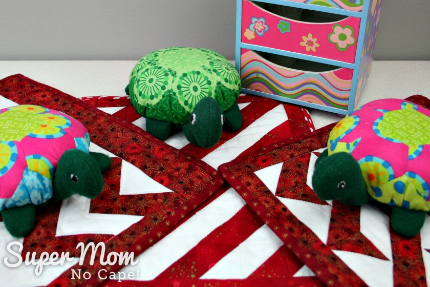 Lexie, Lanie and Rexie the Hexie Turtles sitting on their quilts