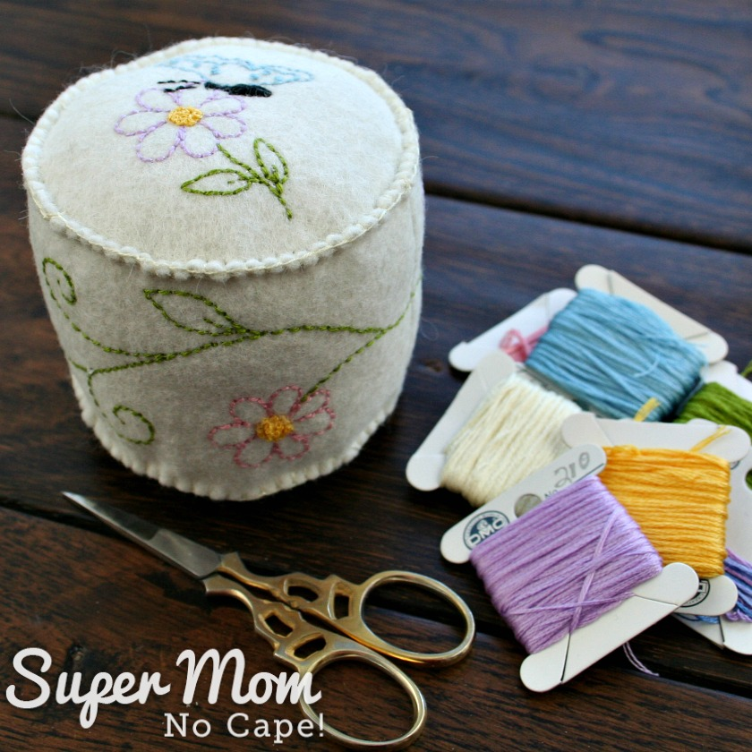 Pincushion made of felt embroidered with butterfly and flowers