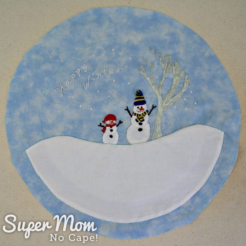 Finished Happy Winter Snowmen piece cut out in large circle