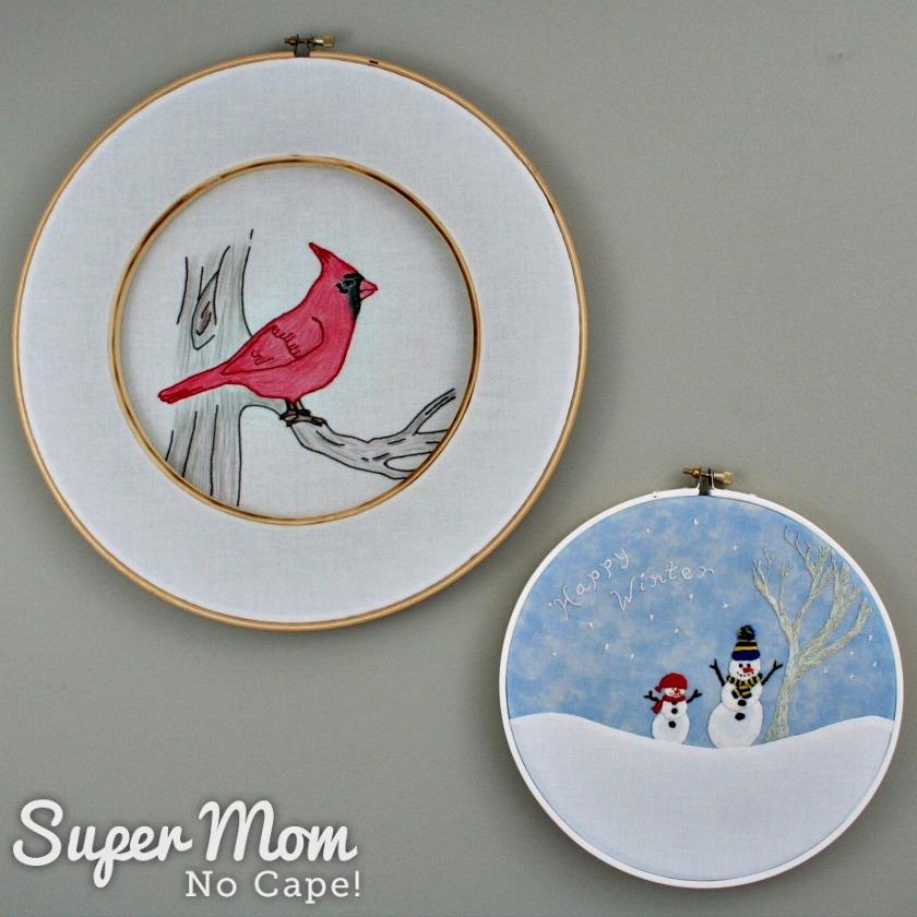 Hoop Art Embroidery Cardinal and Happy Winter Snowmen hanging on a grey wall