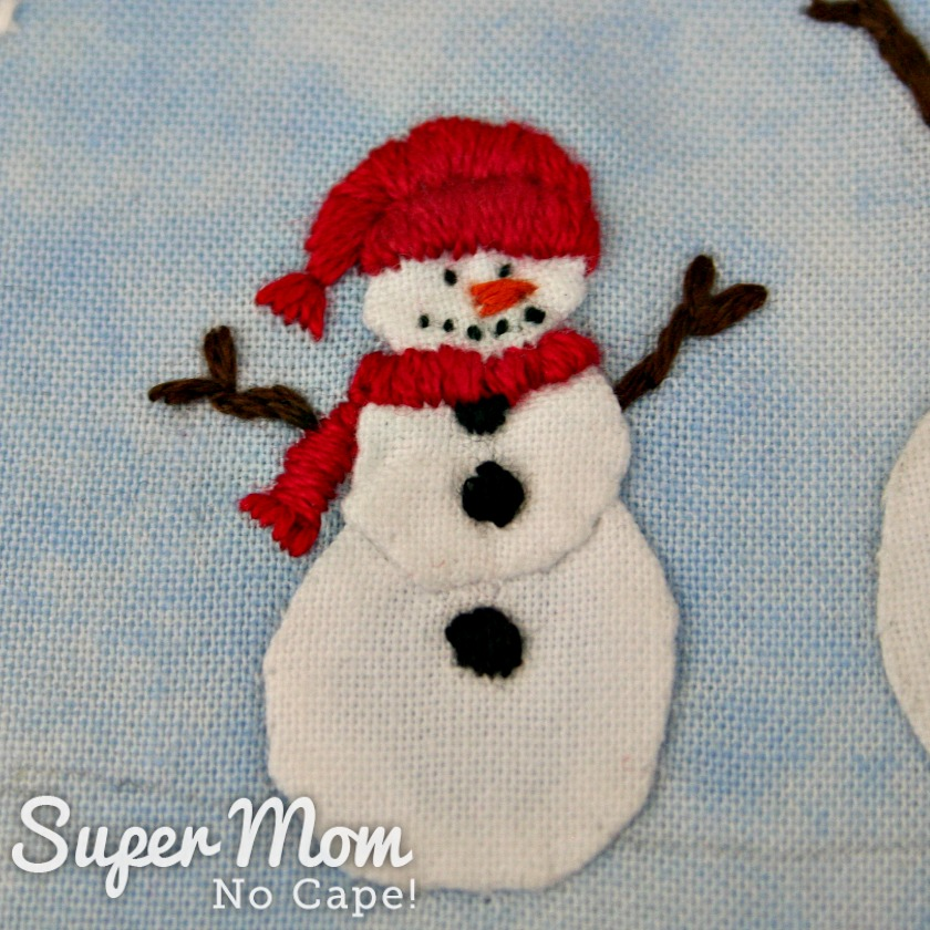 Red hat and scarf embroidered on smaller snowman of the Happy Winter Snowmen Embroidery Pattern