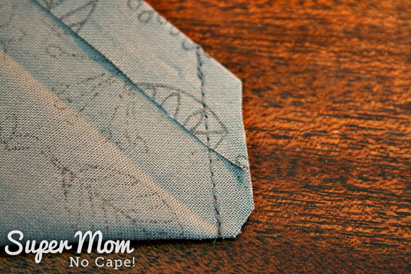 Clipped and trimmed seam allowance on the mitered napkin corner