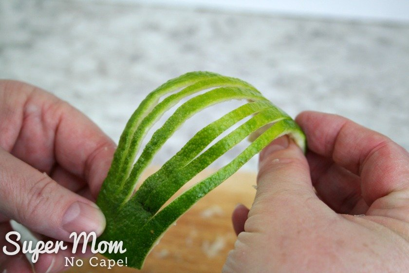 Fanning out the slits cut in the lime rind to make a lime rind fan garnish