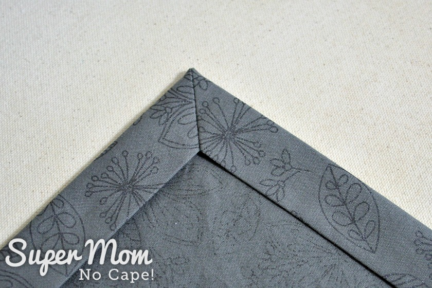 Perfectly mitered corner on grey print napkin
