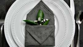 Pocket folded napkin with greenery and babys breath