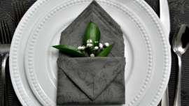 Pocket folded napkin with greenery and babys breath