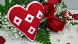 Embroidered Felt I Heart Diamonds and Roses Sachet with a bouquet of red roses in the background