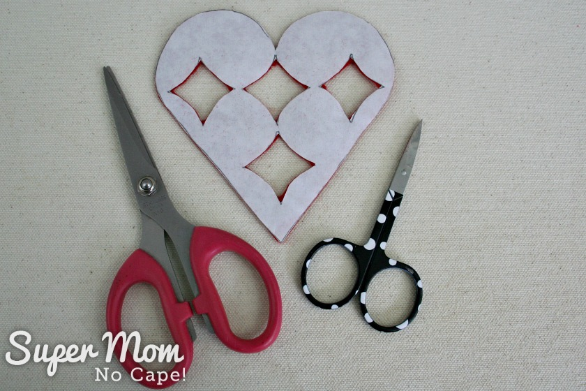 Two different scissors used cut out red felt heart for the I Heart Diamonds and Roses Sachet Pattern