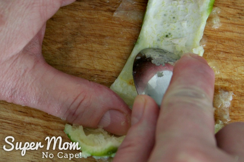Scraping the pith off the lime rind to prepare it to make a lime rind fan garnish
