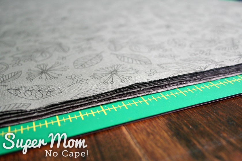 Stack of fabric squares cut to make napkins with mitered corners