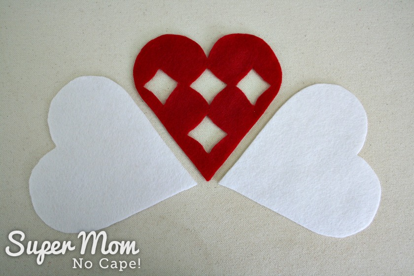 Two white felt hearts and one red felt heart