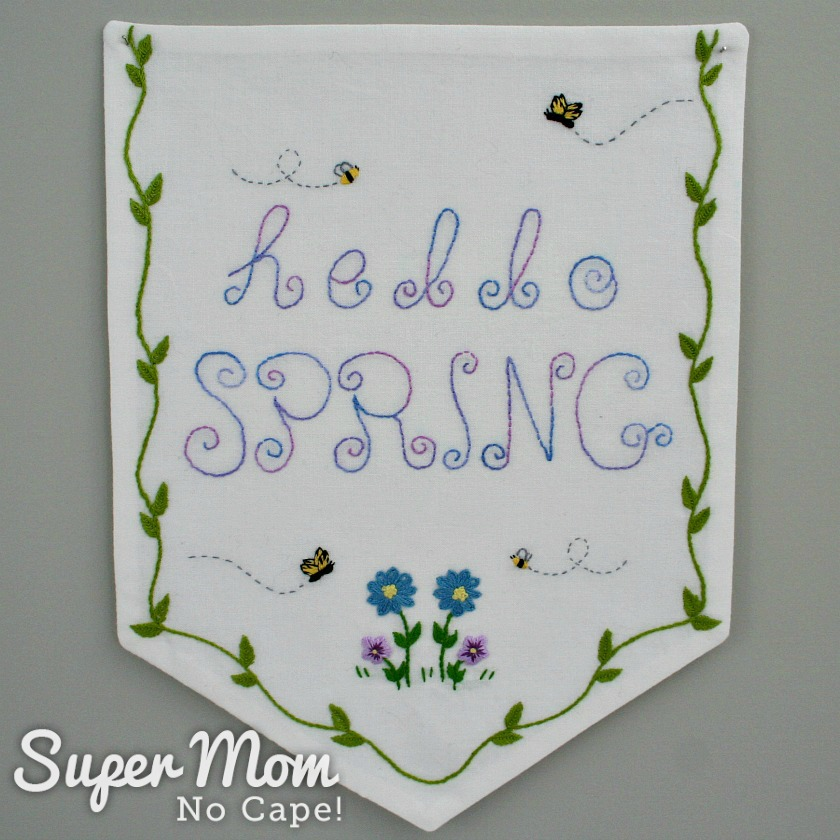 Banner with Hello Spring Embroidery Pattern stitched on it