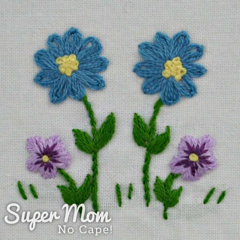 Blue daisies and purple pansies from Hello Spring Embroidery Pattern