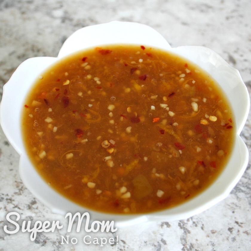 Bowl of homemade orange sauce set aside to cool