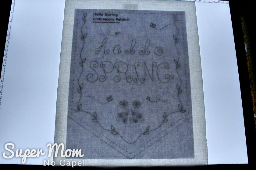 Getting ready to trace the Hello Spring embroidery pattern on to fabric using a Huion light box