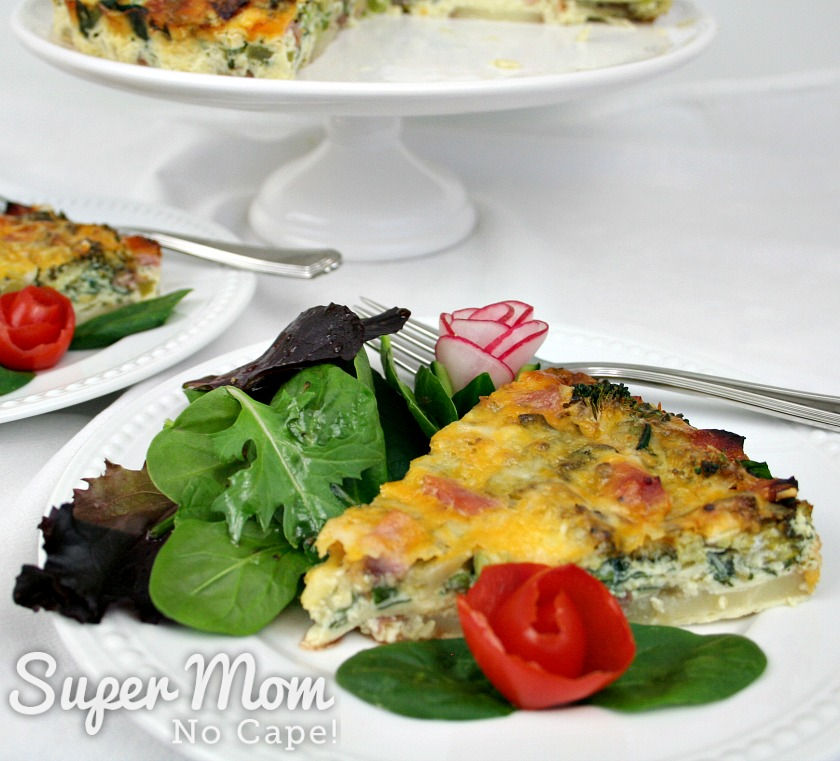 White brunch plates with Crustless Quiche served with salad and tomato and radish rose garnishes