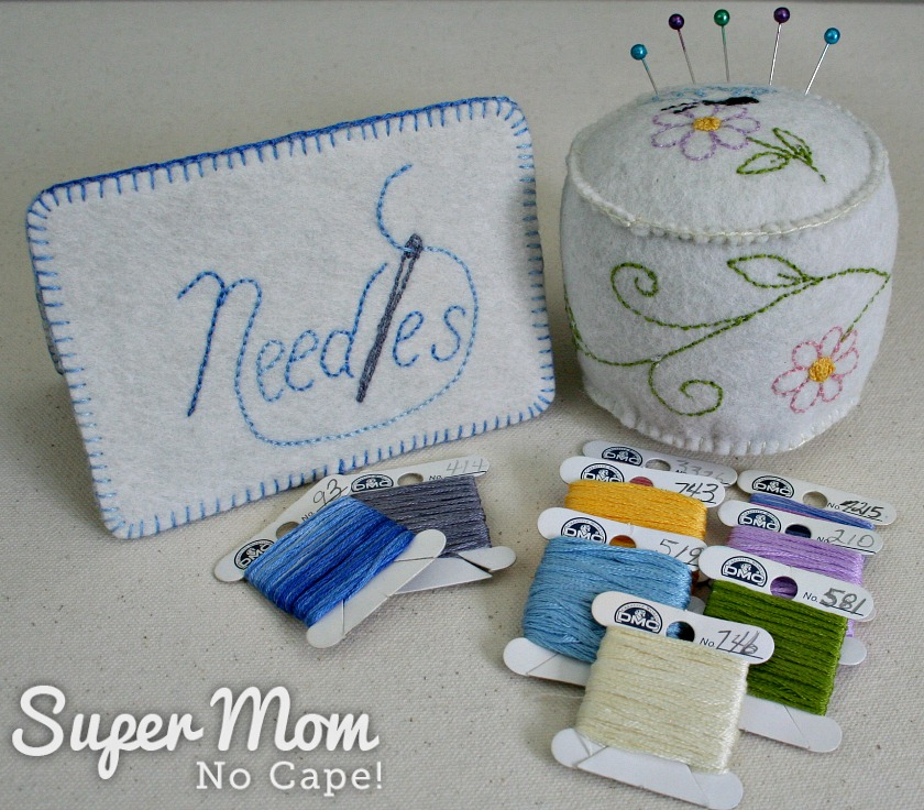 Needles embroidered felt needlebook and pincushion with several floss bobbins