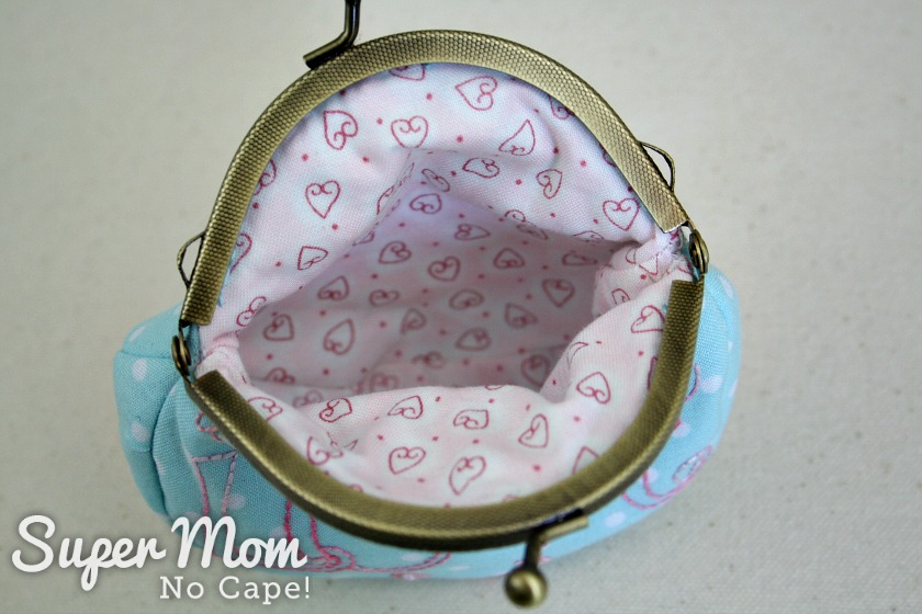Pretty pink with hearts fabric lining of the embroidered coin purse
