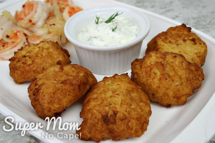 Five Rustic Potato Puffs on platter with bowl of dip and pan fried shrimp in the background