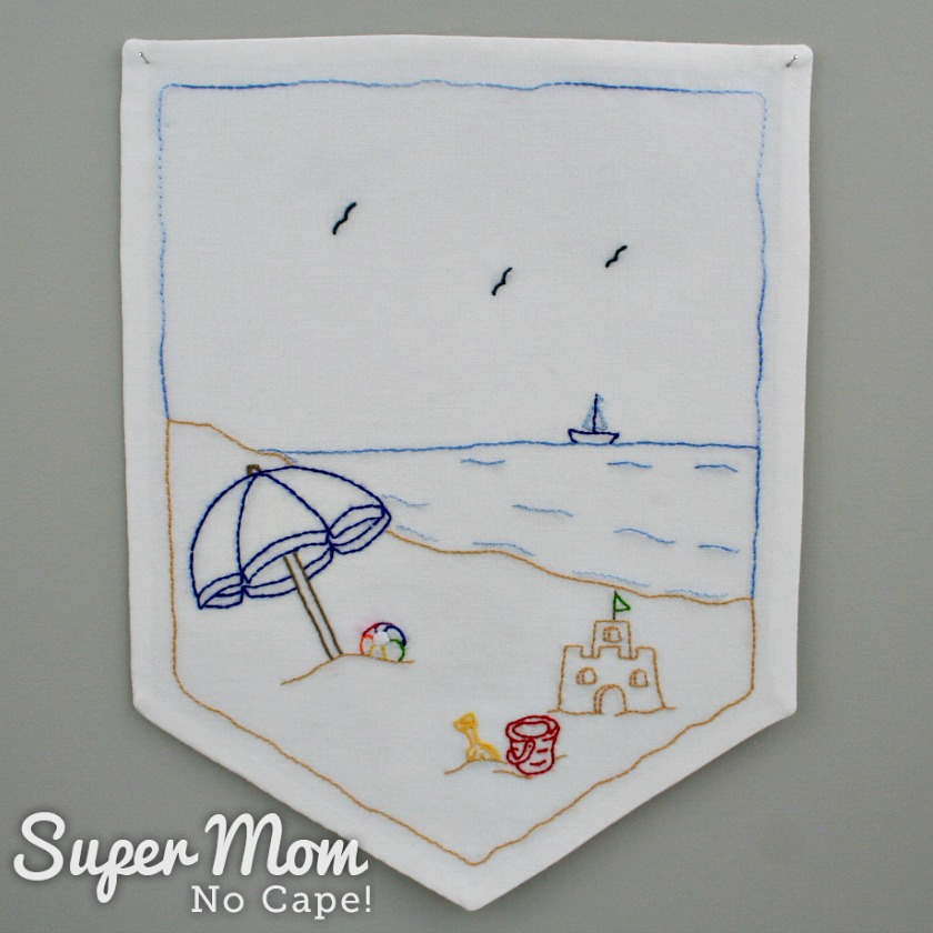 Completed Summer Beach Days embroidery pattern turned into a banner