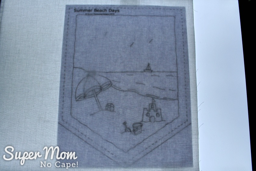 Pattern for Summer Beach Days being traced on white fabric to embroider