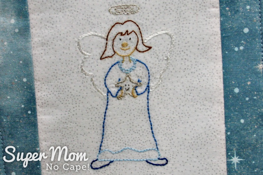 Prudence Angel holding a star embroidery