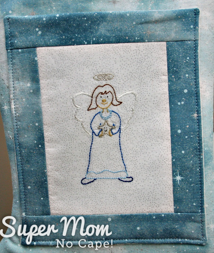 Prudence Angel embroidery pattern embroidered on the pocket of a Christmas stocking