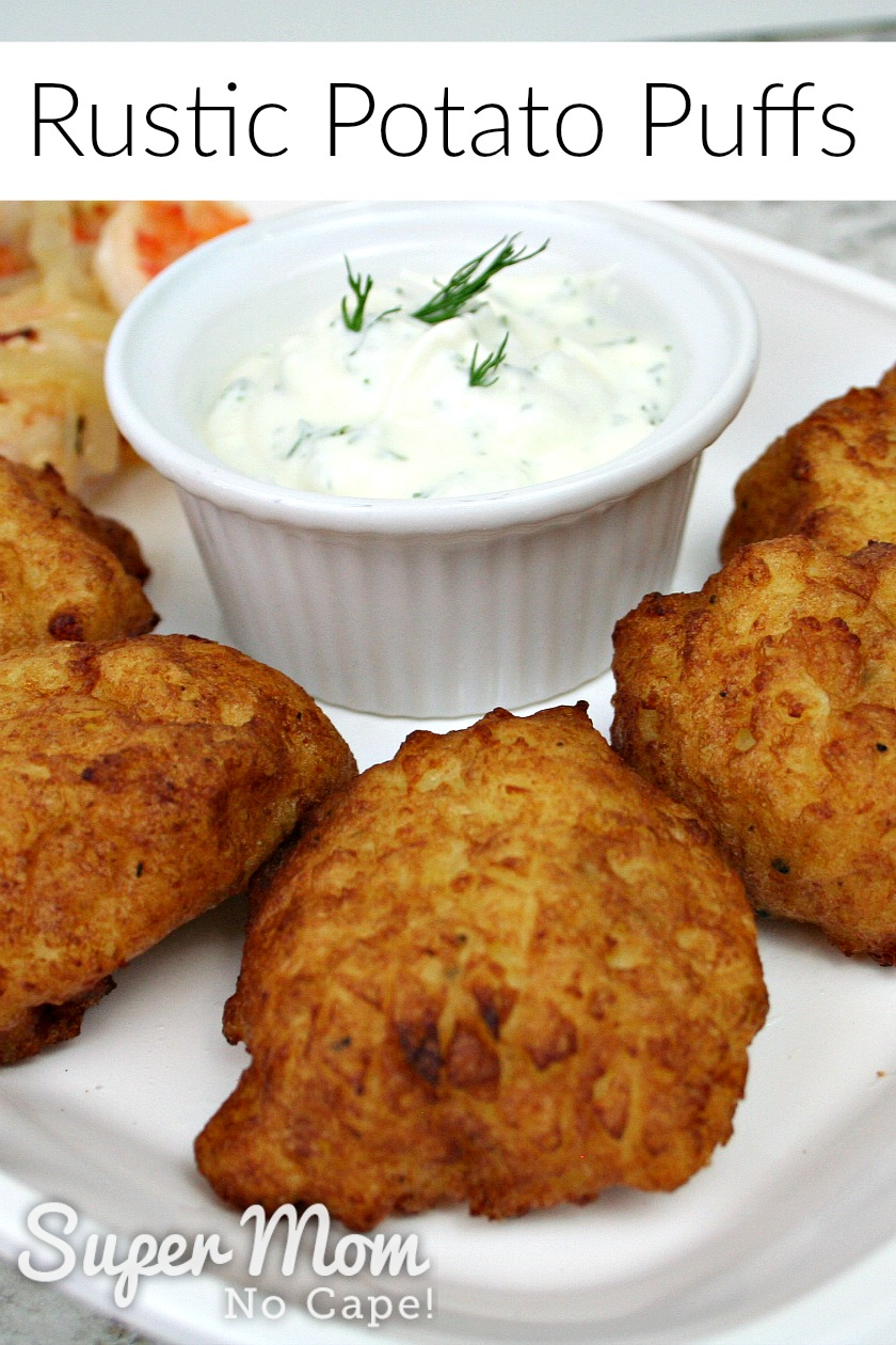 Several Rustic Potato Puffs on a white plate with a white bowl filled with Dilly Greek Yogurt Dip