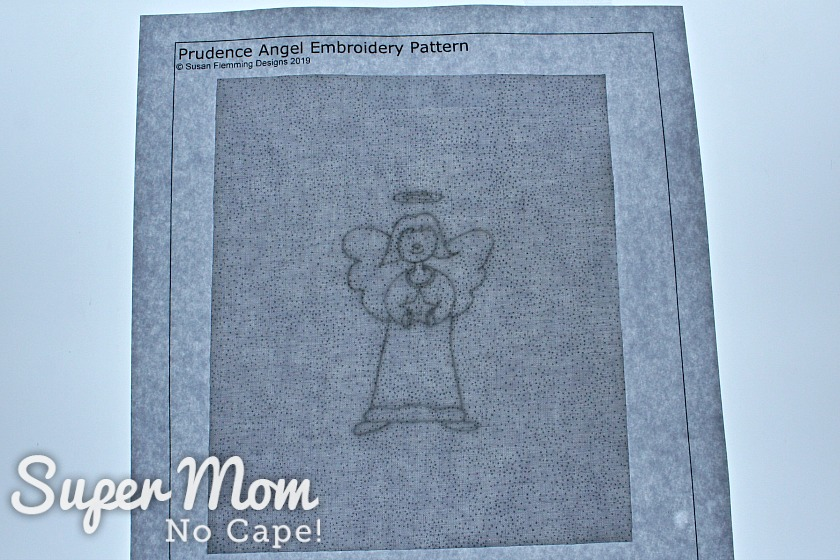 Tracing the Prudence Angel embroidery pattern onto fabric using a Huion lightbox