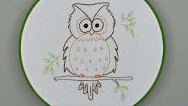 Owain Owl Embroidery Pattern in a Green Painted Hoop