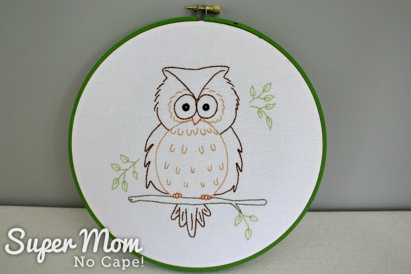 Owain Owl in green painted embroidery hoop