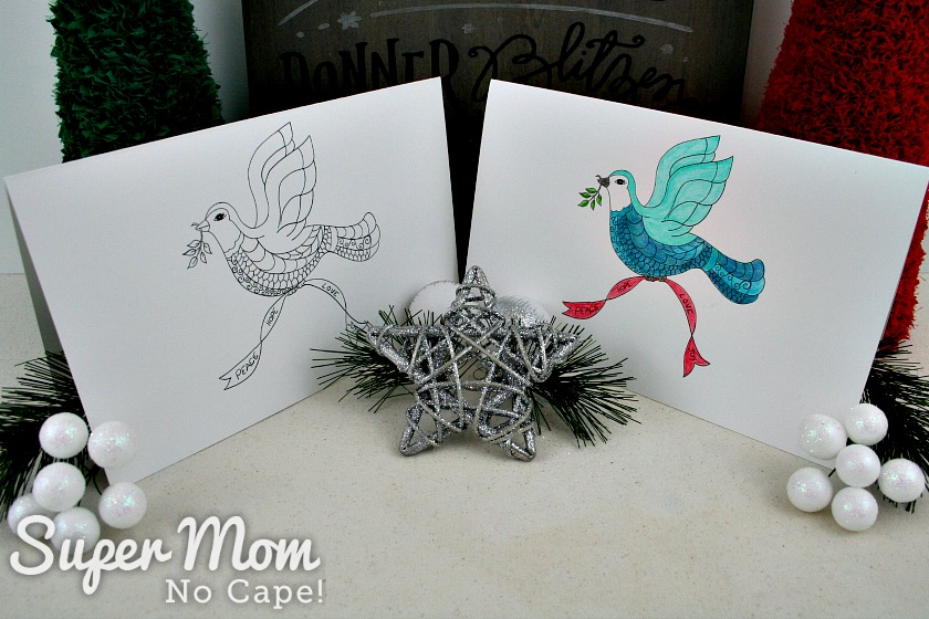 Christmas Dove cards displayed with other Christmas items