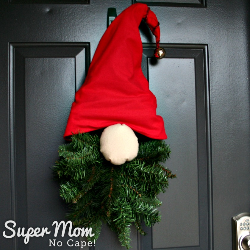 Christmas Gnome Wreath displayed on a black exterior door.