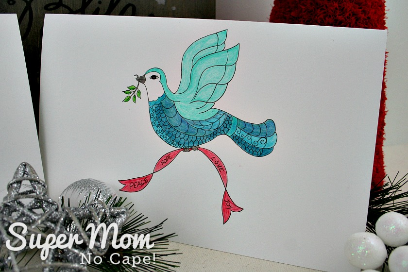 Close up photo of colored Christmas Dove card
